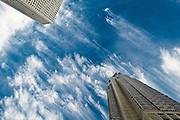 Low angle view of skyscrapers and cloud pattern, Shinjuku district, Tokyo, Japan