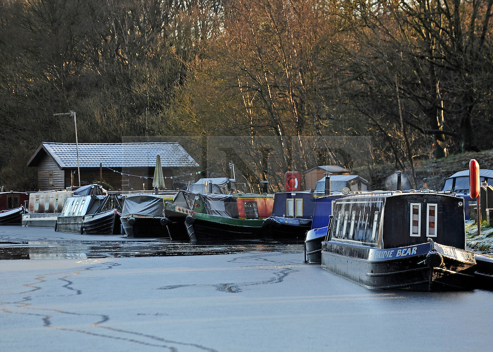 © Licensed to London News Pictures. 18/12/2011, London, UK.  Canal boats in the frozen Leeds and Liverpool Canal, Central Lancashire, today 18 December. Photo credit : Stephen Simpson/LNP