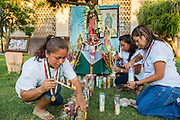 25 JUNE 2012 - PHOENIX, AZ: GEORGINA SANCHEZ, and other immigration activists light candles at an impromptu alter at the Arizona State Capitol in Phoenix, AZ, Monday. The lawsuit, US v. Arizona, determines whether or not Arizona's tough anti-immigration law, popularly known as SB1070 is constitutional. Among other things, the law requires police officers to check the immigration status of anyone whom they arrest, allows police to stop and arrest anyone whom they believe to be an illegal immigrant, makes it a crime for someone to be in the state without valid immigration papers, and makes it a crime to apply for or hold a job in Arizona without proper papers. The federal government sued Arizona because it believes the law is invalid because it is trumped by federal immigration laws. The court struck down most of the law but left one section standing, the section authorizing local police agencies to check the immigration status of people they come into contact with.     PHOTO BY JACK KURTZ