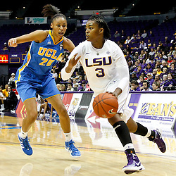 December 13, 2011; Baton Rouge, LA; LSU Lady Tigers guard Bianca Lutley (3) drives past UCLA Bruins guard/forward Rhema Gardner (20) during the first half of a game at the Pete Maravich Assembly Center.  Mandatory Credit: Derick E. Hingle-US PRESSWIRE