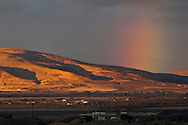 Rainbow at sunrise over the Honey Valley, near Susanville, Lassen County, California