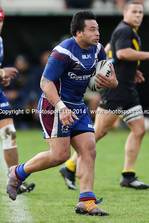 Akarana's Eddy Purcell  carries during  NZRL Pirtek National Premiership Rugby League match, Akarana Falcons v Wellington Orcas at Ellerslie Domain, Ellerslie, Auckland, New Zealand. Saturday  13 September 2014.