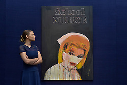 "© Licensed to London News Pictures. 23/06/2017. London, UK. A staff member views ""School Nurse"", 2005, by Richard Prince (estimate GBP3.5-4.5m) at the preview of Sotheby's Contemporary Art Sale in New Bond Street.  The auction, which is dominated by Pop art, takes place on 28 June. Photo credit : Stephen Chung/LNP"