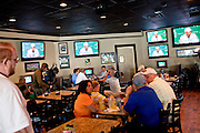 Diners and members of the press witness Tiger Woods' televised press conference at Somewhere in Augusta Bar, just down the road from where it is being broadcasted live at The Augusta National Golf Course in Augusta, Georgia April 15, 2010.