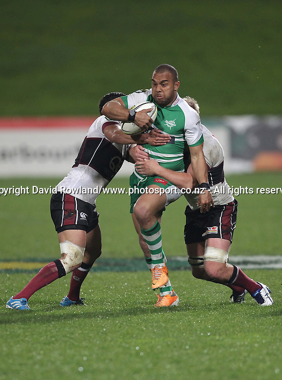 Manawatu`s Nathan Tudreu is tackled by North Harbour`s captain Bryn Hall, left, and Nic Mayhew in an ITM Cup Rugby Match, North Harbour v Manawatu, QBE Stadium, Auckland, New Zealand, Friday, September 12, 2014. Photo: David Rowland/Photosport
