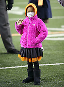Leah Still, daughter of Cincinnati Bengals defensive tackle Devon Still (75), waves as she makes her first visit to the field during a tribute to her and the money raised to treat her illness during the NFL week 10 regular season football game against the Cleveland Browns on Thursday, Nov. 6, 2014 in Cincinnati. The Browns won the game 24-3. ©Paul Anthony Spinelli