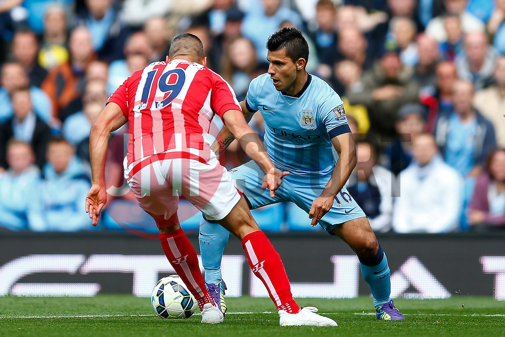 Sergio Aguero of Manchester City is challenged by Jonathan Walters of Stoke - Photo mandatory by-line: Rogan Thomson/JMP - 07966 386802 - 30/08/2014 - SPORT - FOOTBALL - Manchester, England - Etihad Stadium - Manchester City v Stoke City - Barclays Premier League.