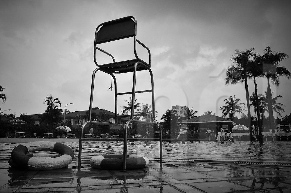 View of one of the lifeguard chair at the Sao Mai swimming-pool in Hanoi, after the rain.