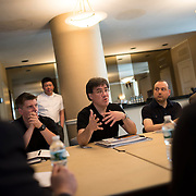 June 3, 2014 - New York, NY : New York Philharmonic Music Director Alan Gilbert, with conductor-composer Matthias Pintscher at his left, works with the young composers and Philharmonic musicians following a rehearsal of the young composers' works on Tuesday afternoon. Three works by little-known composers will be selected for inclusion in the New York Philharmonic's Biennial. CREDIT: Karsten Moran for The New York Times