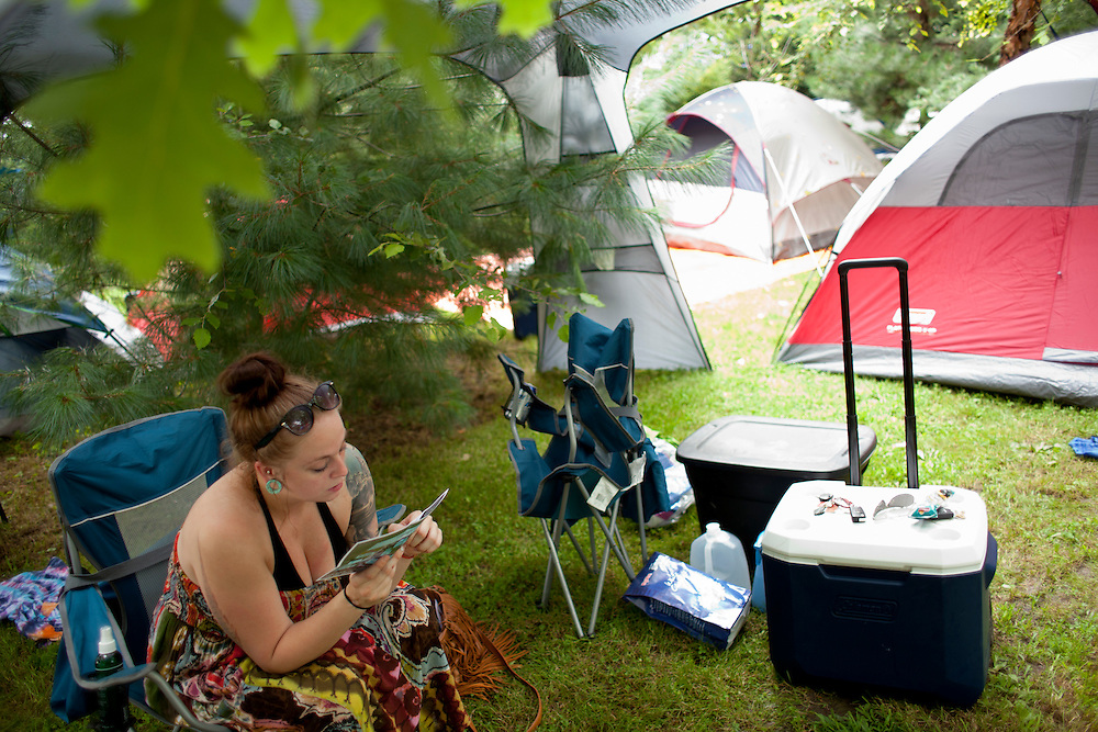 Courtney Mohr relaxes at her campsite on Thursday, July 16, 2015 as people arrive at Camp Euforia, a three-day music festival held on Jerry Hotz's 120-acre farm north of Lone Tree. Mohr, who is from Cedar Rapids, works at a construction company and has been coming to the fest with her boyfriend for the last few years.
