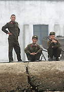 A North Korean soldiers on the pier of the border town of Sunuiju Ocotber 10 DPRK, north korea, china, dandong, border, liaoning, democratic, people's, rebiblic, of, korea, nuclear, test, rice, japan, arms, race, weapons, stalinist, communist, kin jong il