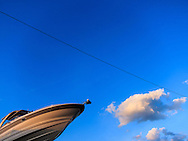 Abstract view of a boat against a blue sky  background.<br />