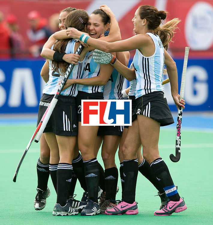 Argentina's Noel Barrioneuevo (27) is congratulated after scoring the 4th goal during their Women's Champions Trophy Final at Highfields, Beeston, Nottingham, 18th July 2010.
