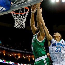 Mar 20, 2013; New Orleans, LA, USA; New Orleans Hornets power forward Anthony Davis (23) blocks a dunk attempt by Boston Celtics power forward Chris Wilcox (44) during the second half of a game at the New Orleans Arena. The Hornets defeated the Celtics 87-86. Mandatory Credit: Derick E. Hingle-USA TODAY Sports
