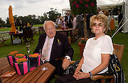 Godfrey Smith and Wendy McWatters, Veuve Clicquot gold Cup, Polo at Cowdray, 18 July 2004. SUPPLIED FOR ONE-TIME USE ONLY> DO NOT ARCHIVE. © Copyright Photograph by Dafydd Jones 66 Stockwell Park Rd. London SW9 0DA Tel 020 7733 0108 www.dafjones.com