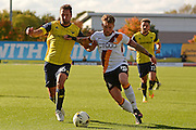 Bradford City striker Billy Clarke (10) and Oxford United defender Phil Edwards (16) battle for possession 0-0 during the EFL Sky Bet League 1 match between Oxford United and Bradford City at the Kassam Stadium, Oxford, England on 15 October 2016. Photo by Alan Franklin.