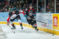 KELOWNA, CANADA - OCTOBER 19: Raymond Grewal #29 of the Prince George Cougars checks Justin Kirkland #23 of the Kelowna Rockets on October 19, 2013 at Prospera Place in Kelowna, British Columbia, Canada.   (Photo by Marissa Baecker/Shoot the Breeze)  ***  Local Caption  ***