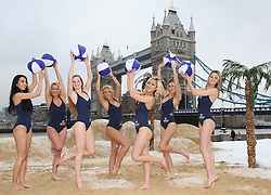 Models on a pop up beach near Tower Bridge in London to cheer up commuters on ' Blue Monday' , reportedly the most depressing day of the year, Monday 21st  January 2013. Photo by: Stephen Lock / i-Images