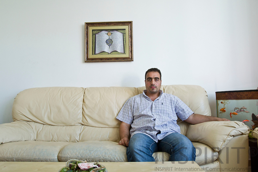 Mustafa Harmoush in Brussels on Friday 30 September 2011 sitting in the same sofa as when his mother phoned him to say she was safe. To go for a story about Syrian-military-defectors written by Alexnder Christie-Miller. Photo Erik Luntang / INSPIRIT Photo.
