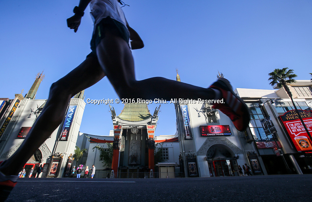 A runner makes her way along Hollywood Boulevard during the 31st Los Angeles Marathon in Los Angeles, Sunday, Feb. 14, 2016. The 26.2-mile marathon started at Dodger Stadium and finished at Santa Monica.  (Photo by Ringo Chiu/PHOTOFORMULA.com)<br /> <br /> Usage Notes: This content is intended for editorial use only. For other uses, additional clearances may be required.