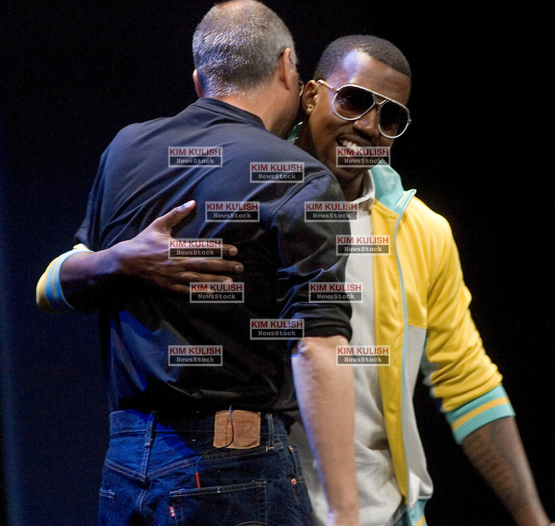 Rapper Kanye West  embraces Apple CEO Steve Jobs  after his performance at Apple Computers Inc. announcement of new iPod products in San Francisco, Calif September 6 2005.   West thanked  jobs for letting him perform following his recent comments about the President. Apple's  Jobs unveiled iTunes 5, iPod Nano and the iTunes-enabled Motorola ROKR mobile phone.  Photo by Kim Kulish/