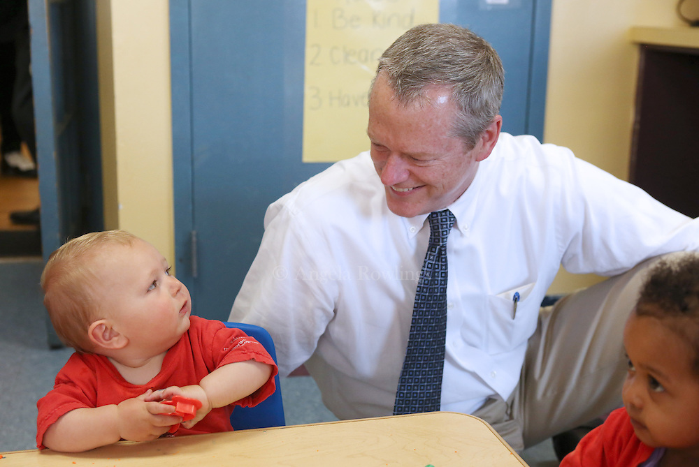 (Boston, MA - 5/26/15) Gus Dellefave, 16 months, sizes up Gov. Charlie Baker as he visits the Toddler 1 class at the Boys & Girls Club in Dorchester, Tuesday, May 26, 2015. Staff photo by Angela Rowlings.
