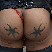 Matching buttocks tattoos of symbol star or figure at Folsom Street East S&amp;M street fair in New York City.<br /> <br /> Body art or tattoos has entered the mainstream it is known longer considered a weird kind of subculture.<br /> <br /> &quot;According to a 2006 Pew survey, 40% of Americans between the ages of 26 and 40 have been tattooed&quot;.