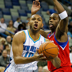 January 4, 2012; New Orleans, LA, USA; New Orleans Hornets shooting guard Eric Gordon (10) drives past Philadelphia 76ers guard Jodie Meeks (20) during the first half of a game at the New Orleans Arena.   Mandatory Credit: Derick E. Hingle-US PRESSWIRE