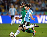 Argentina's forward Lionel Messi (front) controls the ball past Nigeria's defender Danny Shittu during the World Cup South Africa 2010 soccer match, at Soccer City stadium, in Johannesburgo, South Africa, on June 12, 2010.  (Alejandro Pagni/PHOTOXPHOTO)