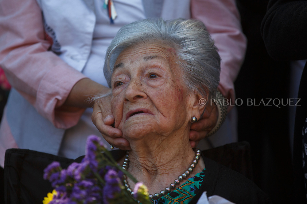 02/07/2017. Ascension Mendieta attends the burial of her father, Timoteo Mendieta, who was assassinated in 1939 by dictator Franco's forces at a cemetery on July 2, 2017 in Madrid, Spain. General Franco forces killed Ascension's father Timoteo Mendieta in 1939 after Spain's Civil War and buried him in a mass grave in Guadalajara's cemetery together with another 22 people assassinated. Argentinian judge Maria Servini used the international human rights law and ordered the exhumation and investigation of Mendieta's mass grave. The exhumation was carried out by Association for the Recovery of Historical Memory (ARMH). Spain's Civil War took the lives of thousands of people on both sides, but Franco continued his executions after the war has finished. Spanish governments has never done anything to help the victims of the Civil War and Franco's dictatorship while there are still thousands of people missing in mass graves around the country. (© Pablo Blazquez)