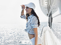 Young woman on yacht side view