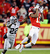 Kansas City Chiefs wide receiver Demarcus Robinson (11) catches an 89-yard Patrick Mahomes pass for a touchdown as Oakland Raiders cornerback Rashaan Melvin (22) defends during the third quarter of an NFL football game in Kansas City, Mo., Sunday, Dec. 30, 2018.   (AP Photo/Colin E. Braley)