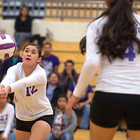 Miyamura Patriot Shinaye Smith (12) hits the ball during the District Championship game against Aztec Tuesday.