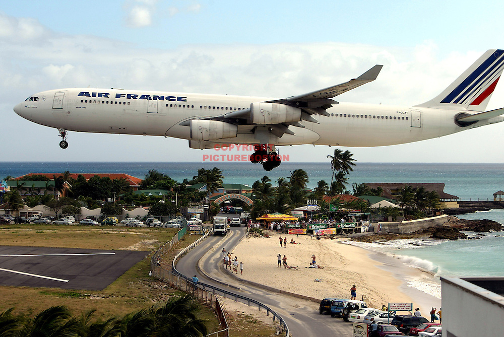 "Various airliners flying in and around St Maarten.   Very long lens. NO trickery or photoshop. All photos are ""real time"" with no trickery or multiple exposure."