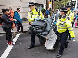 © Licensed to London News Pictures. 08/10/2019. London, UK. Extinction Rebellion sit-in at Westminster where up to two weeks of protest are planned. Police arrest protestors outside the Home Office. Photo credit: Alex Lentati/LNP