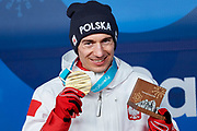 South Korea, PyeongChang - 2018 February 18: Kamil Stoch from Poland poses with his gold medal while Men's Large Hill Individual Medal Ceremony during The 2018 PyeongChang Olympic Winter Games at PyeongChang Medals Plaza on February 18, 2018 in PyeongChang, South Korea.<br /> <br /> Mandatory credit:<br /> Photo by &copy; Adam Nurkiewicz<br /> <br /> Adam Nurkiewicz declares that he has no rights to the image of people at the photographs of his authorship.<br /> <br /> Picture also available in RAW (NEF) or TIFF format on special request.<br /> <br /> Any editorial, commercial or promotional use requires written permission from the author of image.