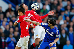 Ander Herrera and Chris Smalling of Manchester United are challenged by Cesc Fabregas of Chelsea - Photo mandatory by-line: Rogan Thomson/JMP - 07966 386802 - 18/04/2015 - SPORT - FOOTBALL - London, England - Stamford Bridge - Chelsea v Manchester United - Barclays Premier League.