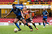 Swindon Town Midfielder Rohan Ince (23) battles for possession with Bradford City Forward Billy Clarke (10)  during the EFL Sky Bet League 1 match between Bradford City and Swindon Town at the Coral Windows Stadium, Bradford, England on 18 March 2017. Photo by Craig Zadoroznyj.