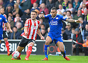 Southamptons Dusan Tadic and Leicester Citys Danny Simpson during the Barclays Premier League match between Southampton and Leicester City at the St Mary's Stadium, Southampton, England on 17 October 2015. Photo by Adam Rivers.