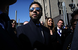March 26, 2019 - Chicago, Illinois, U.S. - Actor JUSSIE SMOLLETT leaves the Leighton Criminal Court building, after all charges were dropped in his disorderly conduct case.  Smollett had been accused of staging a hate crime and filing a false police report. (Credit Image: © Antonio Perez/Chicago Tribune/TNS via ZUMA Wire)