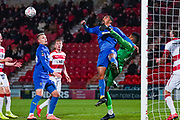AFC Wimbledon forward Kwesi Appiah (9) challenges Doncaster Rovers goalkeeper Seny Dieng (24) during the The FA Cup match between Doncaster Rovers and AFC Wimbledon at the Keepmoat Stadium, Doncaster, England on 19 November 2019.
