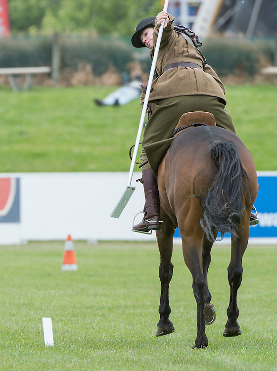 Elizabeth Jennings of Brisbane on Pako, part of The Canterbury Mounted Rifles, puts on a display of Tent Pegging at the Canterbury A&P Show, Christchurch, New Zealand, November 11, 2015. Credit: SNPA /  David Alexander.