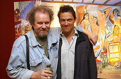 Left to right, MIKE FIGGIS and DOMINIC WEST at a private view of artist Damian Elwes work 'Artists Studios' held at Scream, 34 Bruton Street, London W1 on 29th June 2006.<br />