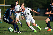 Rice's Nate Cary (9) runs with the ball during the boys soccer game between the The Burlington Seahorses and the Rice Green Knights at Rice Memorial high School on Tuesday afternoon September 15, 2015 in South Burlington, Vermont. (BRIAN JENKINS/for the FREE PRESS)