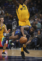 April 1, 2018 - Minneapolis, MN, USA - Minnesota Timberwolves guard Aaron Brooks (30) passes off as he falls to the court under Utah Jazz center Ekpe Udoh (33) late in the fourth quarter on Sunday, April 1, 2018 at Target Center in Minneapolis, Minn. (Credit Image: © Jeff Wheeler/TNS via ZUMA Wire)