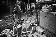 French guyana, approuague.<br /> <br /> Orpaillage clandestin bresilien, camp de base. Les pirogues bresiliennes assurent le ravitaillement de marchandises et des hommes depuis la frontiere bresilienne. Un reseau de pistes permet aux porteurs d'alimenter la foret. Le gouvernement fran&ccedil;ais pretend arreter cette activite et mene des actions coup de poing en envoyant l'armee dans le cadre de l'operations &quot;anaconda&quot; ou autres &quot;harpies&quot;. D'importants stocks de materiel clandestins sont saisis et brules. Souvent, les campements reapparaissent a peine detruits.