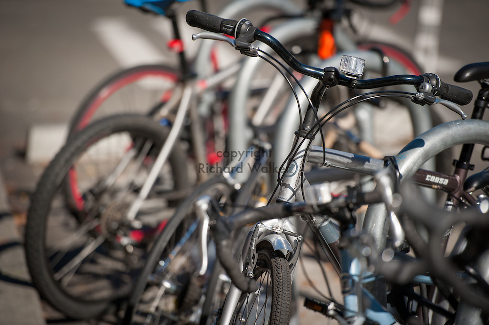 2016 October 11 - Bicycles parked at a bike parking rack, University District, Seattle, WA, USA. By Richard Walker