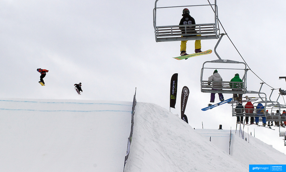 Snowboarders in action during the Billabong Slope-Style 2011 at Snowpark, Wanaka, New Zealand. 5th August 2011
