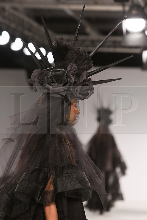 © Licensed to London News Pictures. 31/05/2014. London, England. Collection by Tianyi Li from UEL, University of East London. Graduate Fashion Week 2014, Runway Show at the Old Truman Brewery in London, United Kingdom. Photo credit: Bettina Strenske/LNP