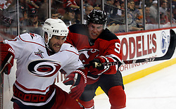 February 18, 2008; Newark, NJ, USA;  New Jersey Devils left wing Zach Parise (9) checks Carolina Hurricanes defenseman Niclas Wallin (7) during the second period at the Prudential Center in Newark, NJ.
